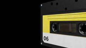 Seamless VJ loop - black and yellow retro cassette. 3D stock video