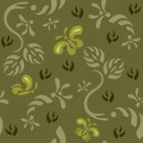 Seamless Wallpaper Background Tile. Seamless continuous wallpaper tile. Butterflies fluttering around foliage created in green tones Royalty Free Stock Images