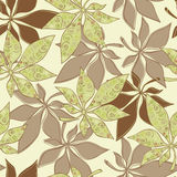 Seamless wallpaper. Beautiful wall-paper without a seam - bright leaves and spirals Stock Photography