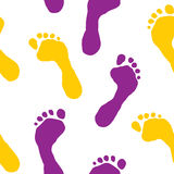 Seamless wallpaper with footprints Stock Photography