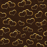 Seamless wallpaper with gold hearts Royalty Free Stock Images