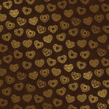 Seamless wallpaper with gold hearts Stock Photos