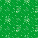 Seamless wallpaper. green polka dot background with a flowers Royalty Free Stock Photos