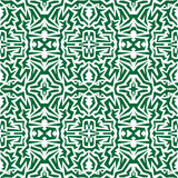 Seamless wallpaper. Motley African repetitive pattern. Green pri Royalty Free Stock Photo