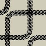 Seamless wallpaper tire tracks pattern Stock Photo