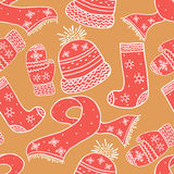 Seamless  warm winter pattern. Background with winter knitted elements. Holidays backdrop. Stock Photos