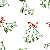 Seamless watercolor Christmas background with mistletoe and red ribbon Stock Image