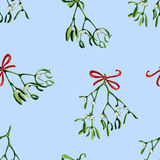 Seamless watercolor Christmas background with mistletoe and red ribbon Stock Images