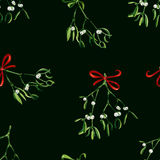 Seamless watercolor Christmas background with mistletoe and red ribbon Royalty Free Stock Photos