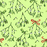 Seamless watercolor Christmas background with mistletoe and red ribbon Royalty Free Stock Photography