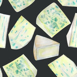 A seamless watercolor pattern with the blue cheeses. Painted on a black (dark) background. Stock Images