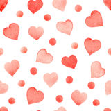 Seamless watercolor pattern with colorful hearts - pink, purple, blue tints. Seamless watercolor pattern with colorful red hearts and dots. Hand-painted stock illustration