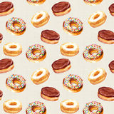 Seamless watercolor pattern with hand drawn baked donuts Stock Photos