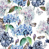Seamless watercolor pattern with a hydrangea, iris and butterflies. Stock Photo