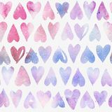 Seamless watercolor pattern with regular colorful hearts stock image