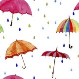 Seamless  watercolor pattern. Umbrellas and rain drops on white background. Multicolors umbrellas and rain drops on white background Stock Photos