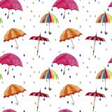 Seamless  watercolor pattern. Umbrellas and rain drops on white background. Multicolors umbrellas and rain drops on white background Royalty Free Stock Image