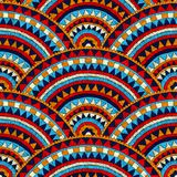 Seamless wavy embroidered pattern. Handmade. Blue, red, white an. D orange colors. Prints for textiles. Ethnic and tribal motifs. Complex patchwork ornament vector illustration