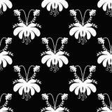 Seamless white cartoon flowers pattern on black background Stock Image