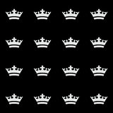 Seamless white crown pattern. Black background stock image
