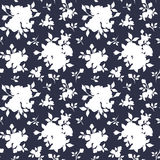 Seamless white floral pattern on dark blue. Vector illustration. Stock Photos
