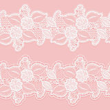 Seamless white lace border on a pink background. Horizontal elegant floral pattern for wedding invitations and cards. Royalty Free Stock Photo