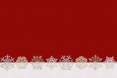 Seamless winter background with snow. Red and white 100% seamless winter background with snowflakes and empty space for your text Stock Photos