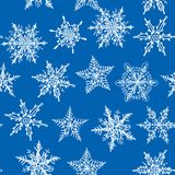 Seamless winter background with snowflakes on blue Royalty Free Stock Photography