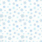 Seamless winter background with snowflakes. Holiday Christmas pattern. Royalty Free Stock Images