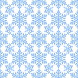 Seamless winter background with snowflakes. Holiday Christmas pattern. Stock Images
