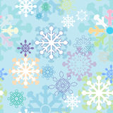 Seamless winter background with stylized snowflakes Royalty Free Stock Photography