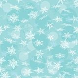 Seamless winter background with white snowflakes. Stock Photography