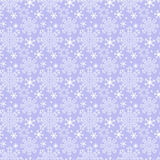 Seamless winter blue Wallpaper with Snowflakes Stock Photo