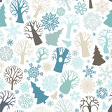 Seamless winter forest pattern. Various deciduous trees and firs, snowflakes on white background.  Boundless texture can be used for web page backgrounds Stock Photography