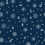 Seamless winter pattern with doodle snowflakes. Royalty Free Stock Photo