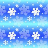 Seamless winter pattern with snowflakes on a bright blue and blue background. Delicate bright winter pattern