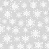 Seamless winter pattern. Snowflakes on a gray background. For your design Royalty Free Stock Photo