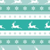 Seamless winter pattern with white snowflakes and deers with antlers. Royalty Free Stock Images