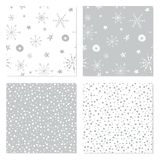 Seamless winter patterns. Set of Christmas backgrounds with hand drawn snowflakes. Vector illustrations. Holiday themed seamless patterns for wrapping paper Stock Photos