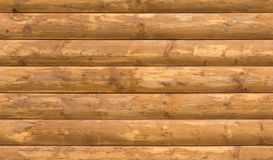 Seamless wooden round timber wall. Seamless wooden round timber country house wall texture Royalty Free Stock Images