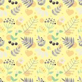 Seamless yellow background with flowers and berries Stock Images