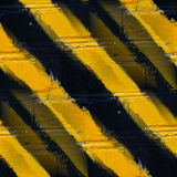 Seamless yellow black stripes stone wall wallpaper Stock Images