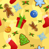 Seamless yellow Christmas background. Seamless yellow background with all sorts of Christmas symbols Stock Photo