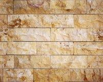 Seamless facing stone texture. Seamless yellow decoration facing stone masonry texture stock photo