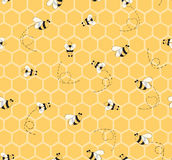 Seamless yellow pattern with bees and honeycombs background for baby textile design. Stock Photo