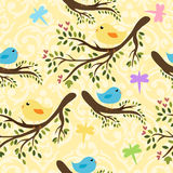 Seamless yellow pattern with cute birdies Stock Photography