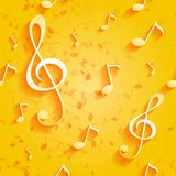 Seamless yellow pattern with music notes and key Stock Images