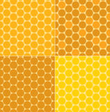 A seamless yellow patterns - vector honeycombs Stock Image