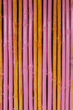 Seamless yellow pink bamboo stick striped pattern Royalty Free Stock Photo