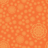 Seamless Yellow Snowflakes Print on Orange Stock Photo